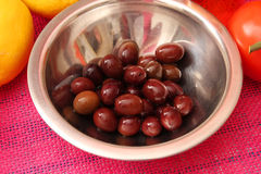 Black olives. Some fresh black olives in a bowl Stock Image