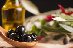 Black Olives and Virgin Olive Oil Stock Photos
