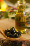 Black Olives and Virgin Olive Oil. Olives and olive oil. Food background Stock Images