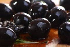 Black olives on a wooden table. Stock Photography