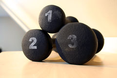Black One, Two and Three Pound Weights. Set of weights for light workout in one, two and three pound sizes - Black stock photos