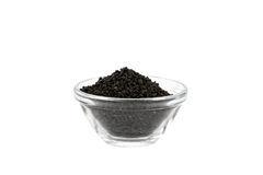 Black onion seeds in glass bowl Stock Photo