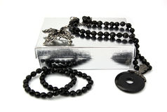 Black onyx christmas gift. Christmas gift composed by box and necklace of black stones Stock Photography
