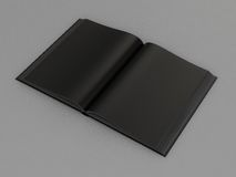 Black open book. On on gray skin High resolution Royalty Free Stock Photos