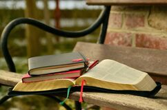Black Open Book on the Brown Wooden Bench Royalty Free Stock Image