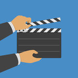 Black opened clapperboard in hands. Movie production clapper board. Cinematography concept. Vector illustration in modern flat style. EPS 10 Stock Image