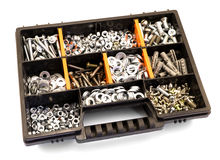 Black and orange box organizer for the screws, dowels, self-tapping screws and washers  Stock Images