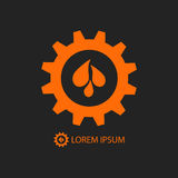 Black and orange gear wheel with water drops Royalty Free Stock Photos