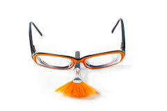 Black with orange glasses on white background Stock Image