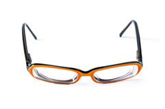 Black with orange glasses on white background Stock Photography