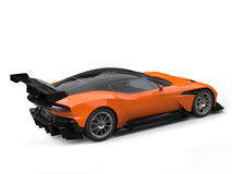 Black and orange modern sports super car - rear wing side view Royalty Free Stock Photography
