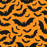 Black and orange pattern with bats. Black and orange vector seamless pattern for Halloween Stock Photography