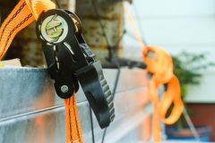 Black and orange ratchet ties. Black and orange mechanical ratchet tie downs for trailer Royalty Free Stock Photography