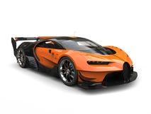 Black and orange supercar - studio shot Stock Images
