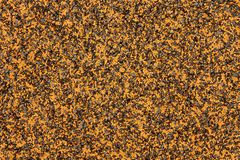A black and orange textured floor Stock Image
