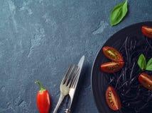 Black organic spaghetti stock photos