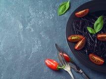 Black organic spaghetti stock images