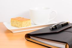 Black organizer with coffee and cake ,coffee break Stock Image
