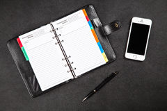 Black organizer on a table Royalty Free Stock Photo