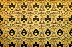 Black ornament. Pattern painted in black on a yellow background effect of antiquity Royalty Free Stock Photos