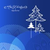 Black ornamental tree. Stylized ornamental christmas tree on blue background Stock Images