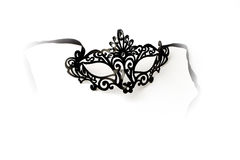 Black Ornate Masquerade Mask on White Background. Photos of beautiful Black ornate masquerade mask on white background perfect for parties and celebrations and Stock Images
