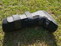 A black Orthopedic or medical boot, cast or footwear royalty free stock photo