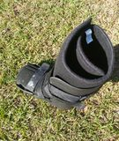 A black Orthopedic or medical boot, cast or footwear stock photography