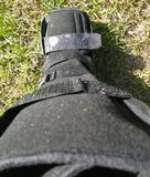 A black Orthopedic or medical boot, cast or footwear stock image