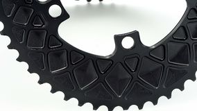 Black oval bicycle chainring gear rotating stock footage