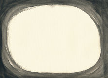 Black oval frame on textured paper. Textured ivory paper sheet painted black from all sides, creating horizontal oval copy space inside dark frame Royalty Free Stock Images