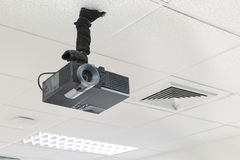 A black overhead projector on ceiling indoors. A black overhead projector on ceiling indoors royalty free stock images