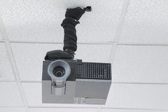 A black overhead projector on ceiling indoors Royalty Free Stock Images