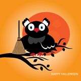 Black owl witch sitting on a tree with broom Stock Image