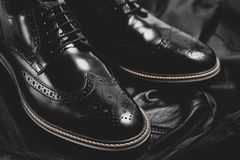Black oxford polished shoes on black  background. Shoes shine Royalty Free Stock Photos