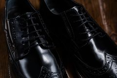 Black oxford polished shoes. Closeup of male Fashion black shoes Stock Photos