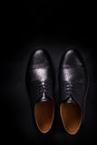 Black oxford shoes on  background. Top view. Copy space. Black oxford shoes on black background. Top view. Copy space Royalty Free Stock Photos