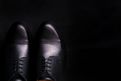 Black oxford shoes on  background. Top view. Copy space. Black oxford shoes on black background. Top view. Copy space Royalty Free Stock Photography