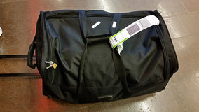 Black packed bag Stock Images