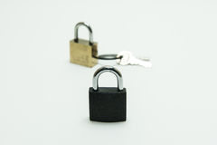 Black padlock(combination lock, bicycle lock) locked isolated wh Stock Photos