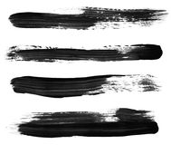 Black Paint Brush Strokes. Variety of black paint brush strokes, isolated on white.  High resolution, each stroke photographed separately for best focus Stock Images