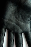 Black Paint on Palm. Hand Skin Background stock images