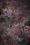 Black painted cloth studio background with magenta and goldenrod yellow paint dabs Royalty Free Stock Image