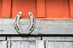 A Black Painted Horseshoe. On Barn Wall Stock Photography