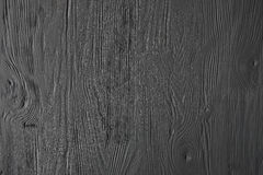 Black  painted wooden texture, background and wallpaper. Royalty Free Stock Images