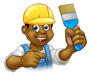 Black Painter Decorator with Paintbrush. A handyman painter decorator cartoon character holding a paintbrush and pointing Royalty Free Stock Photography