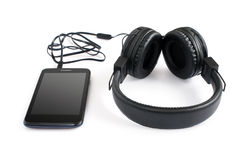 Black Pair of Headphones and smartphone Royalty Free Stock Photo
