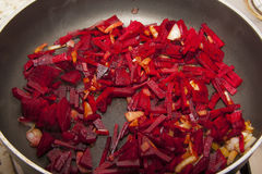 Black pan with beetroot Royalty Free Stock Images