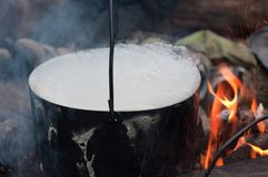 Black pan on a bonfire Royalty Free Stock Image