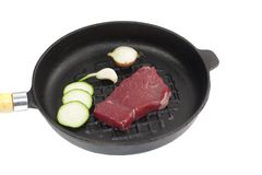 Black pan with meat. Black pan with beef meat and onion Royalty Free Stock Photo